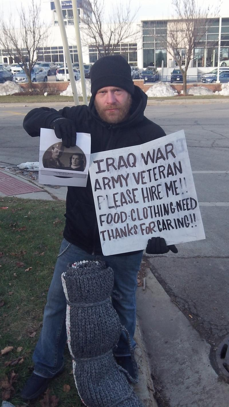 Homeless Vet - serviced in Oak Park, IL., Shown w/ a sleeping mat.