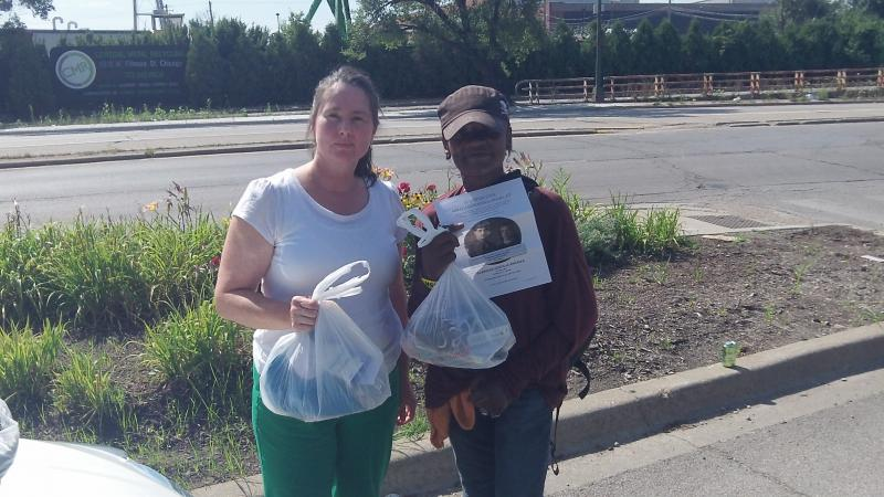 Jeanne Coatar GCA volunteer (left) seen working with a homeless woman in Chicago